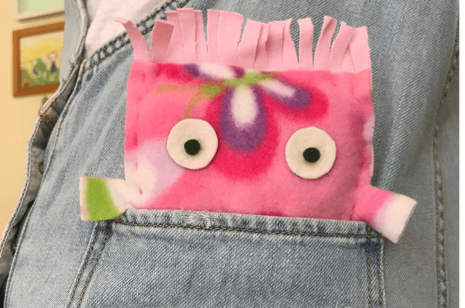 a hand sewn softie in a jeans pocketpocket