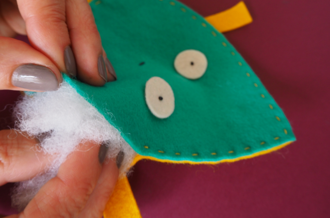 adding stuffing to a soft toy