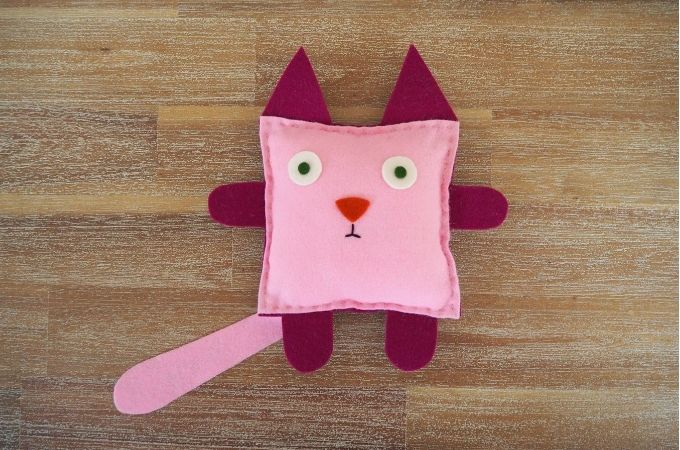 sewing a cat stuffed toy